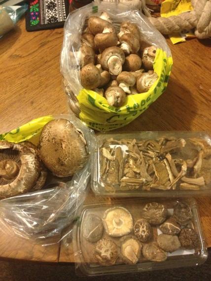 The mushrooms for this week's recipes. 2.5 lbs crimini. 2.0 lbs portobello. 0.5lbs dried porcini. and 0.1 oz dried shiitake.