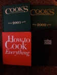 Four cookbooks. Cooks Illustrated Bound Annuals from 2001 and 2009. The Science of Good Cooking from Cooks Illustrated, 2012. How to Cook Everything (The Red Book) by Mark Bittman, 2008.