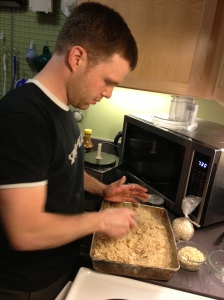 Sam gently mixes the crumble... but not too much.