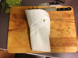 Just like a tiny infant, bring all of the leaves together and tightly wrap in the paper towel.
