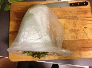 Put the paper towel-wrapped veg into a plastic bag. Twist the top closed.