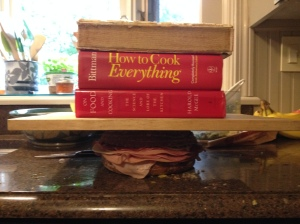 Layer meats and cheeses, and remaining 1/3 of tapenade. Weight sandwich and press for 30 minutes. I'm using the Holy Trinity: McGee, Bittman and Child.